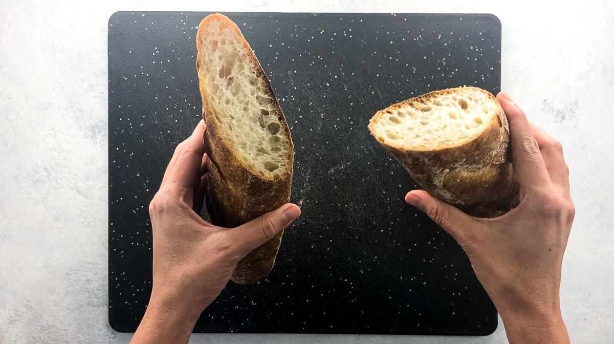 holding a baguette
