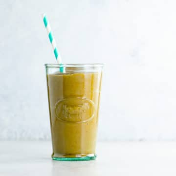 healthy pumpkin spice smoothie recipe in a glass with a straw