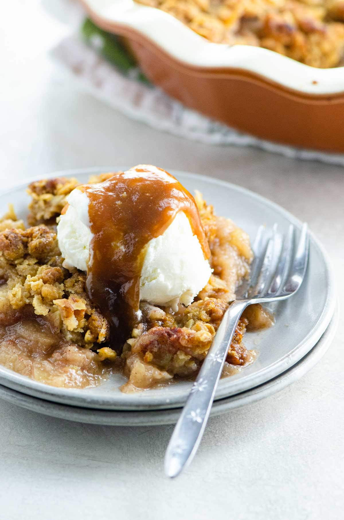 Best Old Fashioned Apple Crisp Recipe with ice cream and caramel sauce