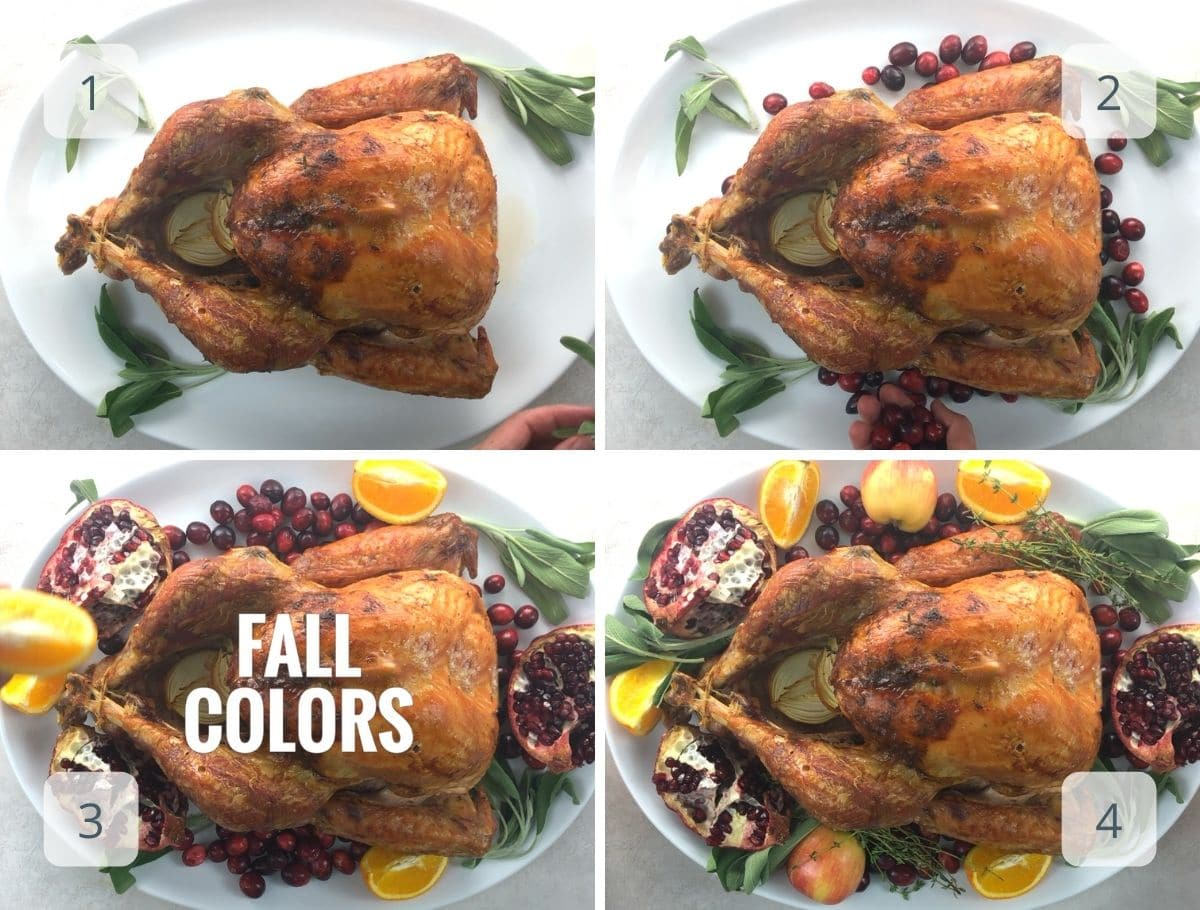 adding herbs and fruit to a platter with a roasted turkey