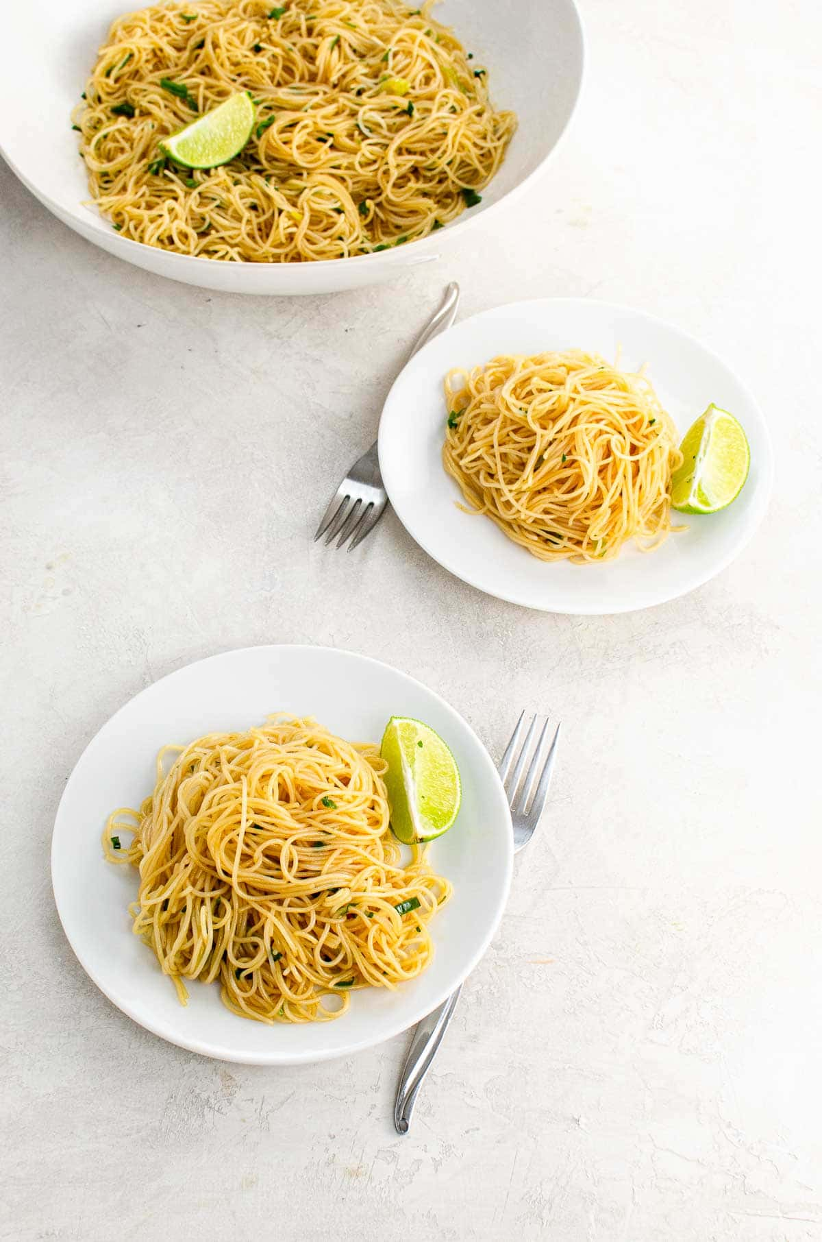 Servings of a vegan rice noodles recipe on white plates