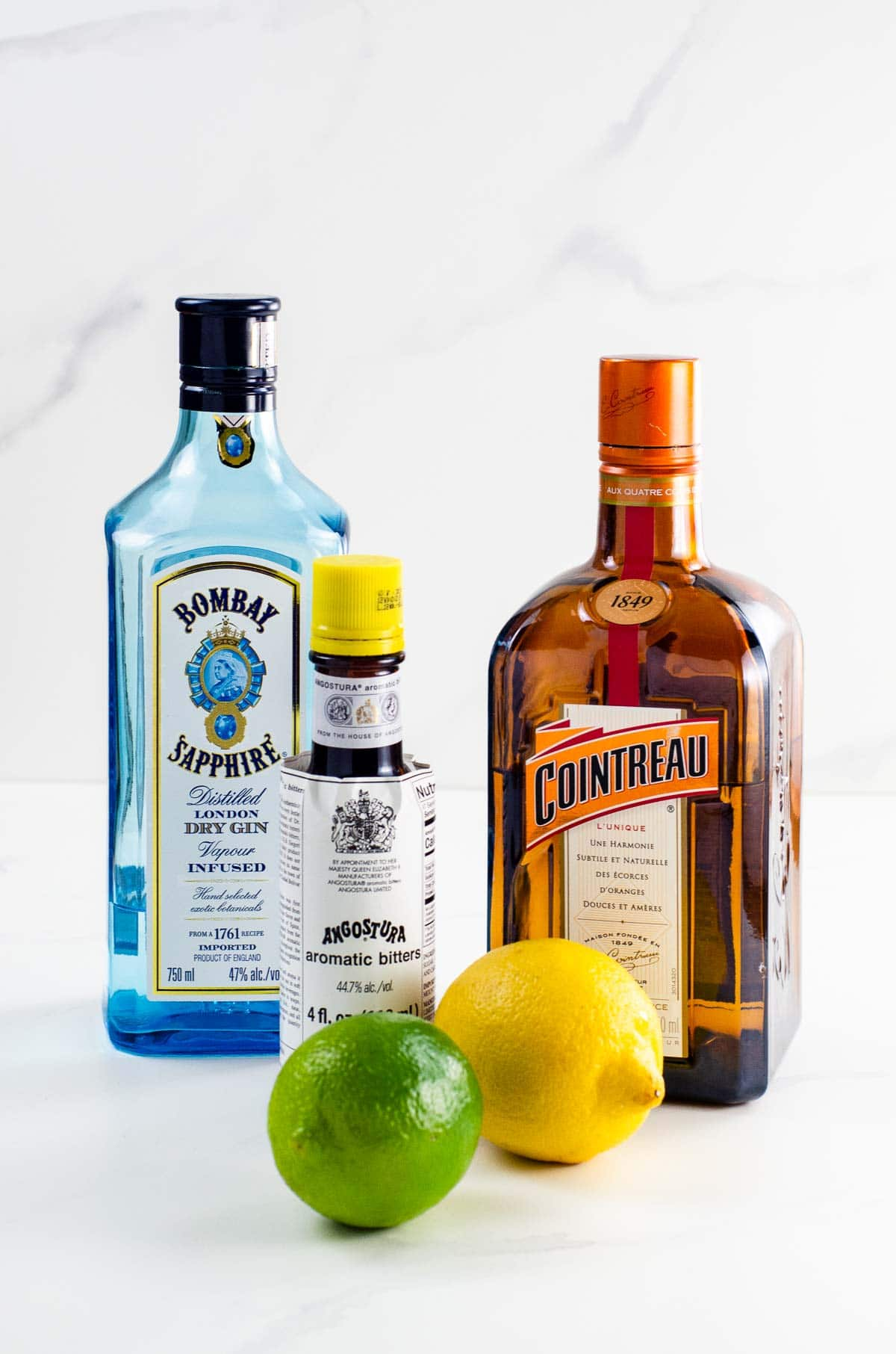 gin, cointreau, angostura bitters, lemon, and lime
