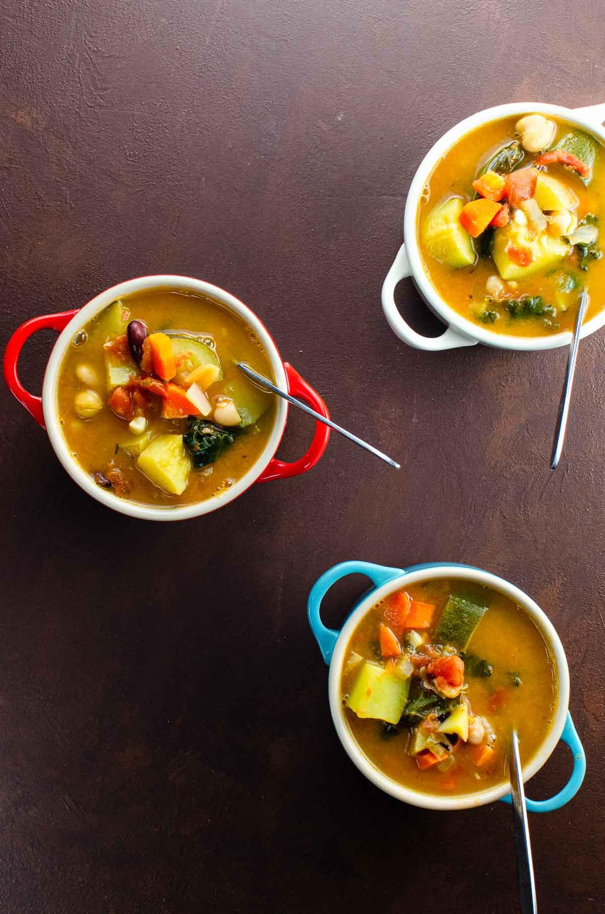 Vegan minestrone soup in mini le creuset pots