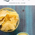 a bowl of vegan queso with tortilla chips