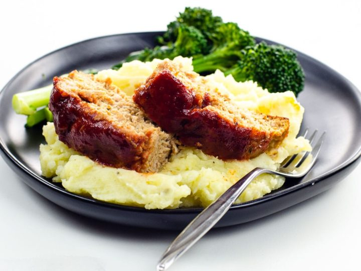 bbq meatloaf made with ground turkey with mashed potatoes and broccolini