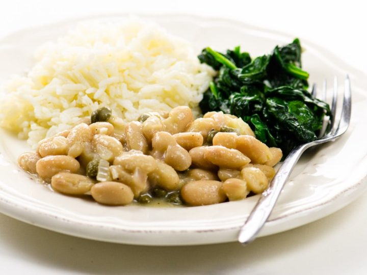 Garlicky Sauteed Spinach and Vegetarian Piccata with Cannellini Beans on a plate