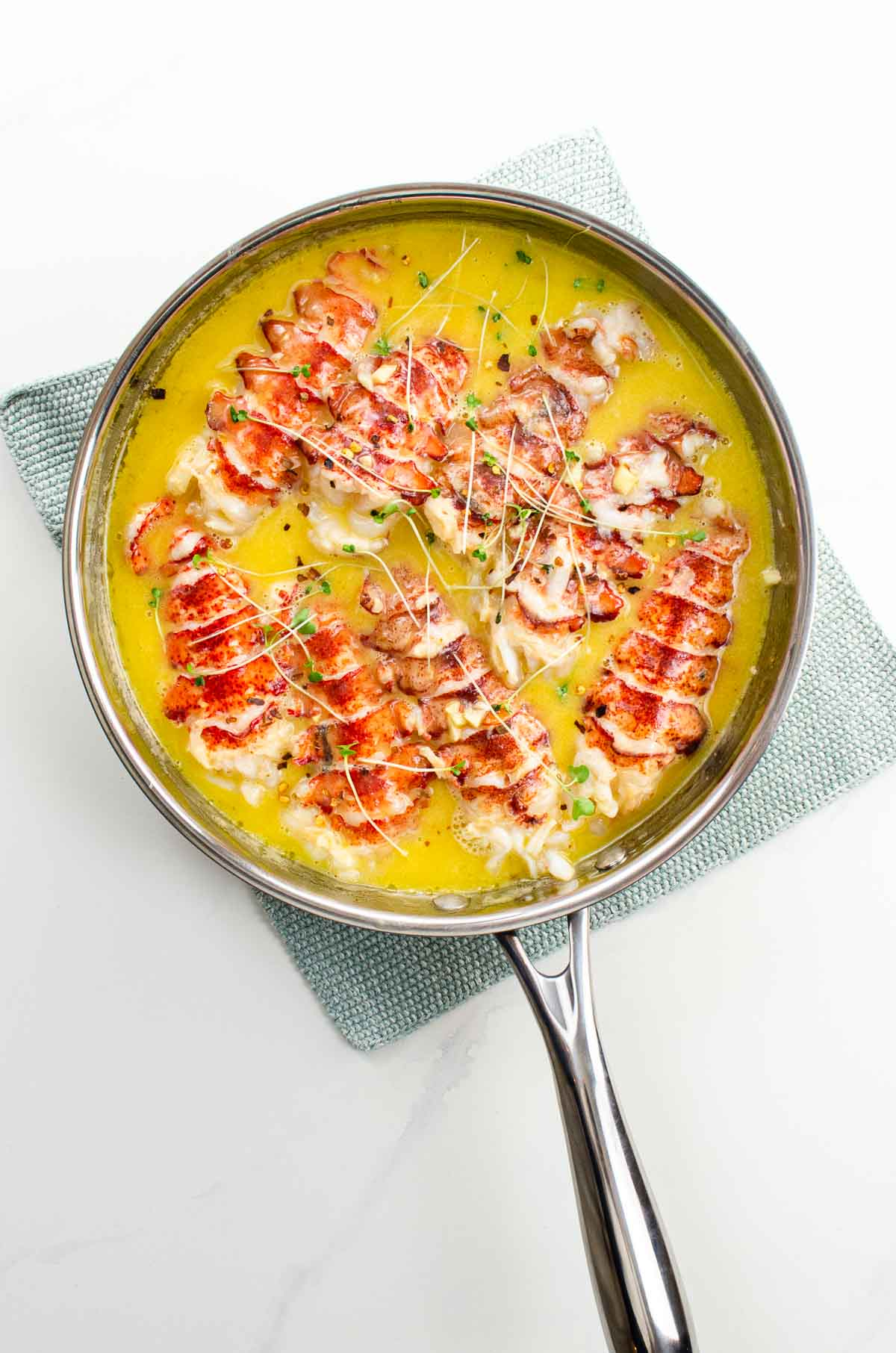 lobster poached in butter in a pan