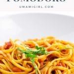 spaghetti al pomodoro in a white bowl (actually linguine)