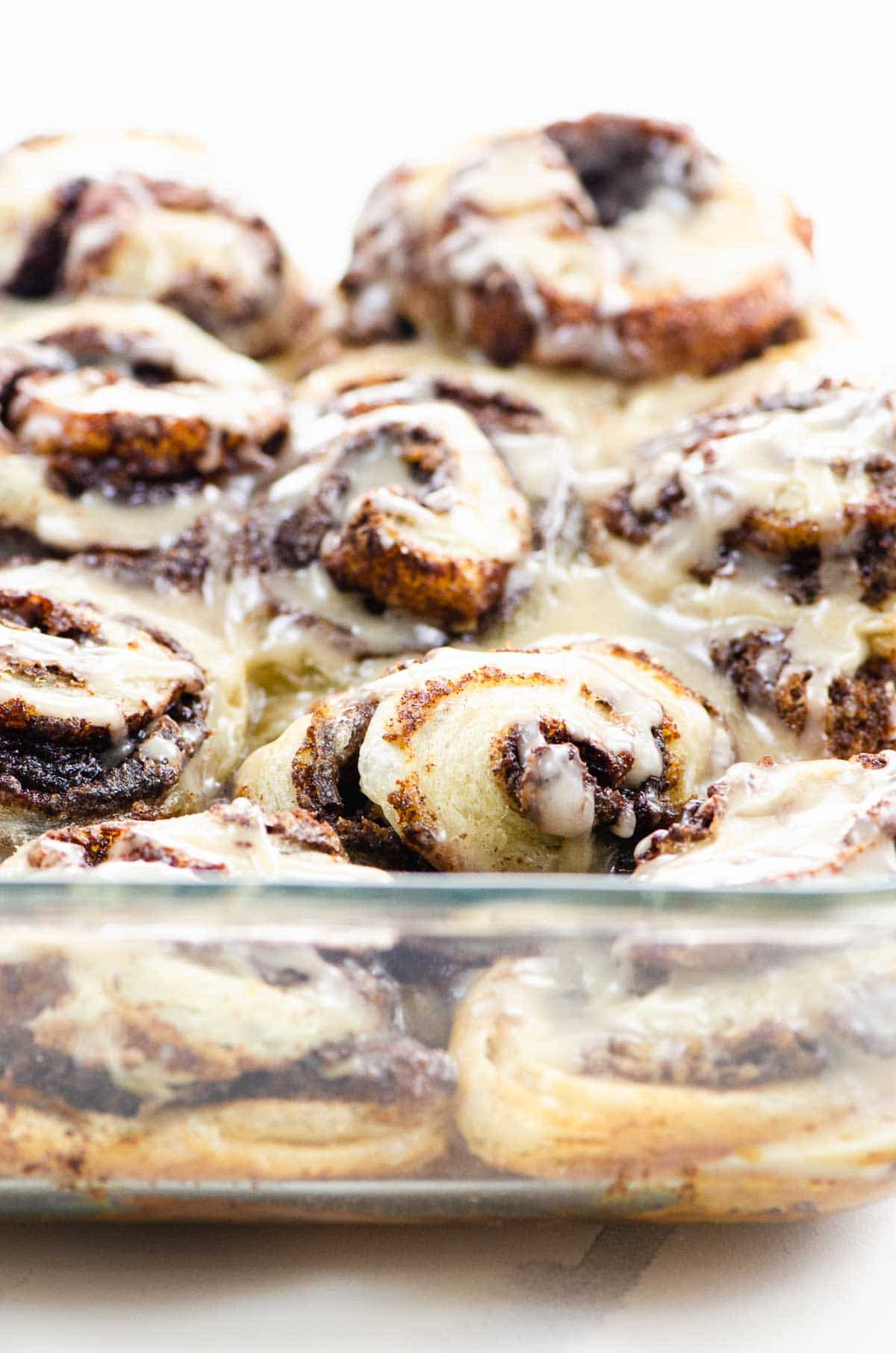 puff pastry cinnamon rolls in a glass baking pan