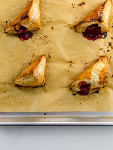 strawberry turnovers on a sheet pan