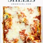 a baking pan of stuffed pasta shells with ricotta, spinach, and mushrooms