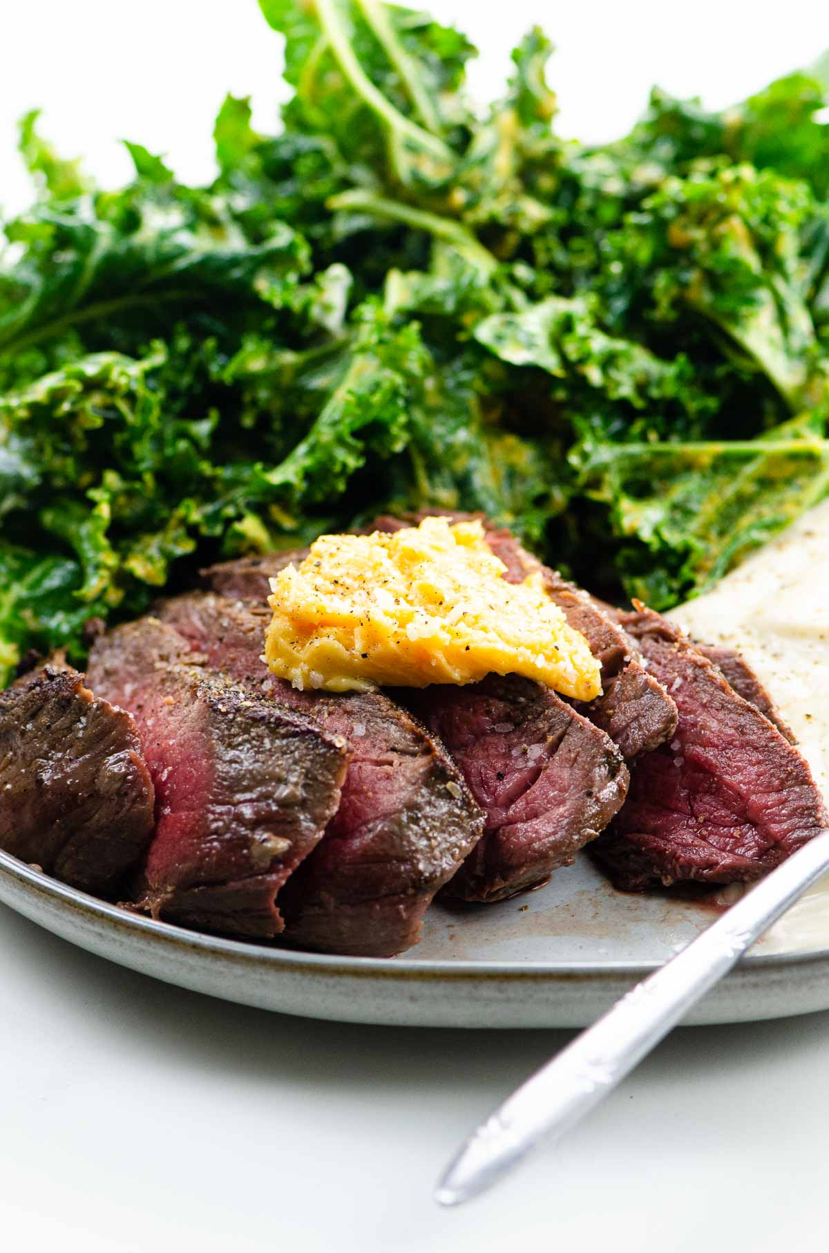 Top Sirloin Steak with Miso Butter, mashed cauliflower, and kale salad