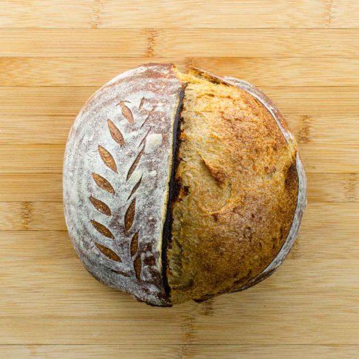 sourdough rye bread on a cutting board for best sourdough recipes