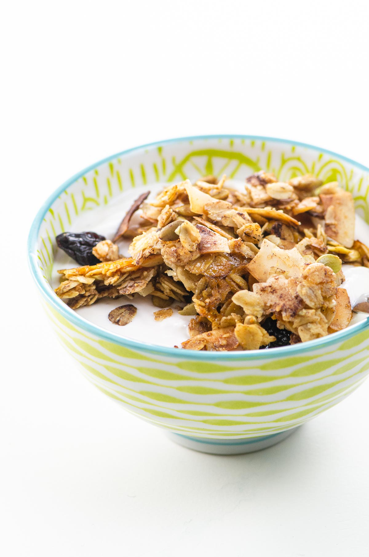 cinnamon granola with almonds, coconut, and dried cherries in a pretty bowl