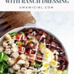 cobb salad with ranch dressing in a white bowl