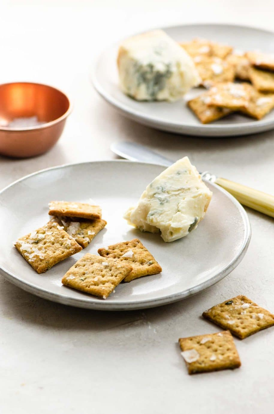 sourdough crackers and cheese on plates