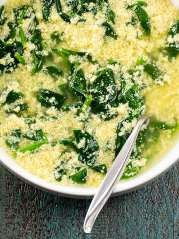 stracciatella alla romana (italian egg drop soup) in a white bowl
