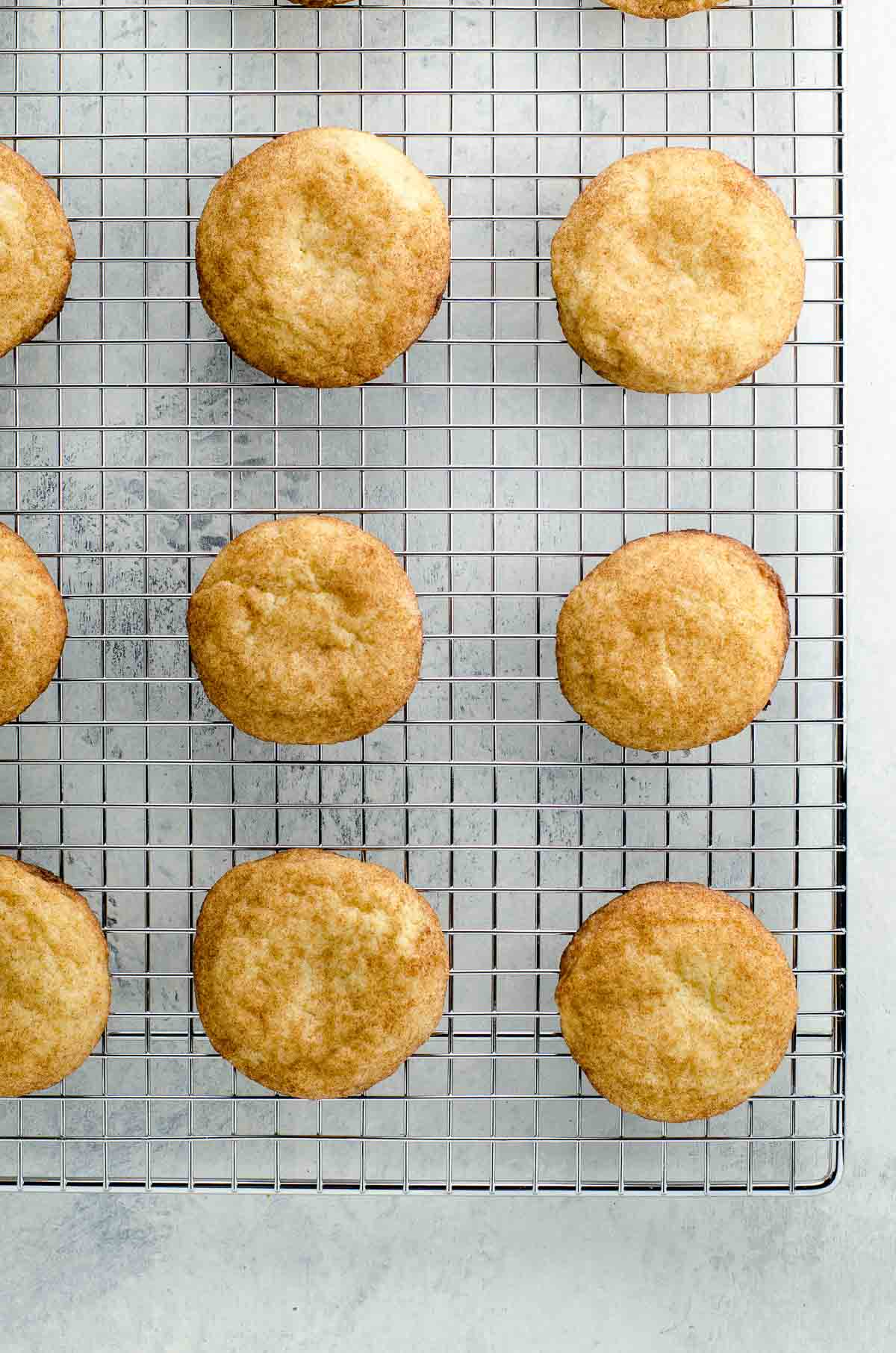 the best chewy snickerdoodle recipe on a cooling rack