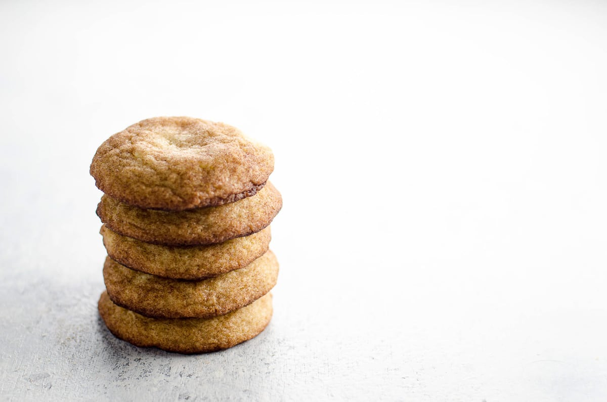 a stack of chewy snickerdoodles on a light background