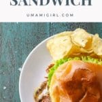 soft shell crab sandwich with lettuce, tomato, and mayo on a brioche bun