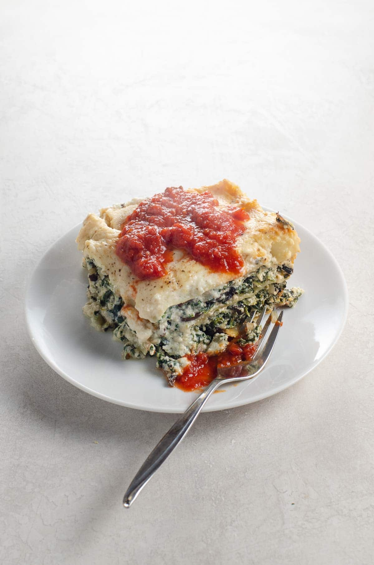 spinach bechamel lasagna with portobellos on a plate