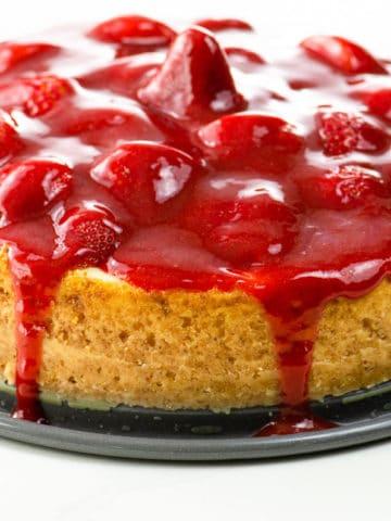 Vanilla bean cheesecake with strawberry sauce