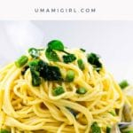 vegetarian carbonara with asparagus and ramps in a white bowl