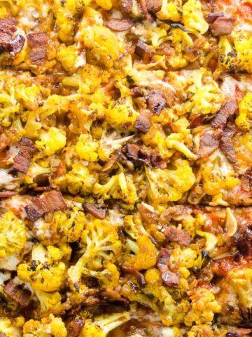 pizza amatriciana with cauliflower on a sheet pan