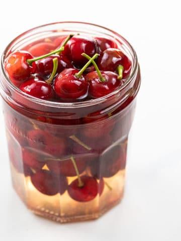 homemade maraschino cherries in a glass jar