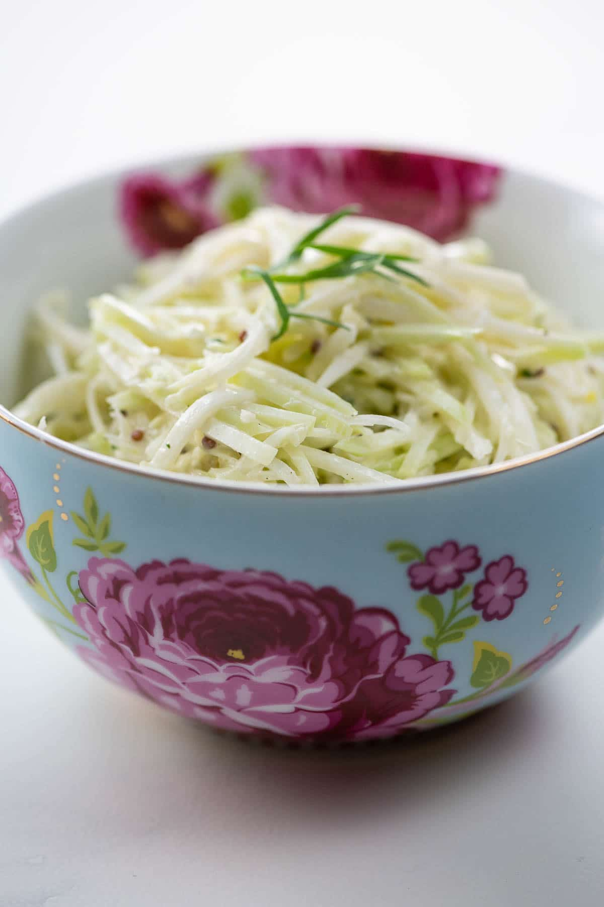 kohlrabi remoulade in a beautiful blue and pink bowl