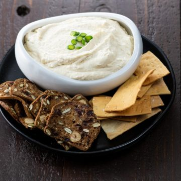 pub cheese in a white bowl with two kinds of crackers