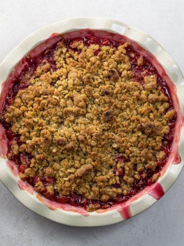 sour cherry crisp in a deep dish pie plate