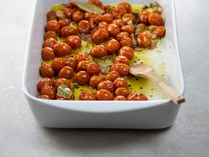 tomato confit in a white roasting pan