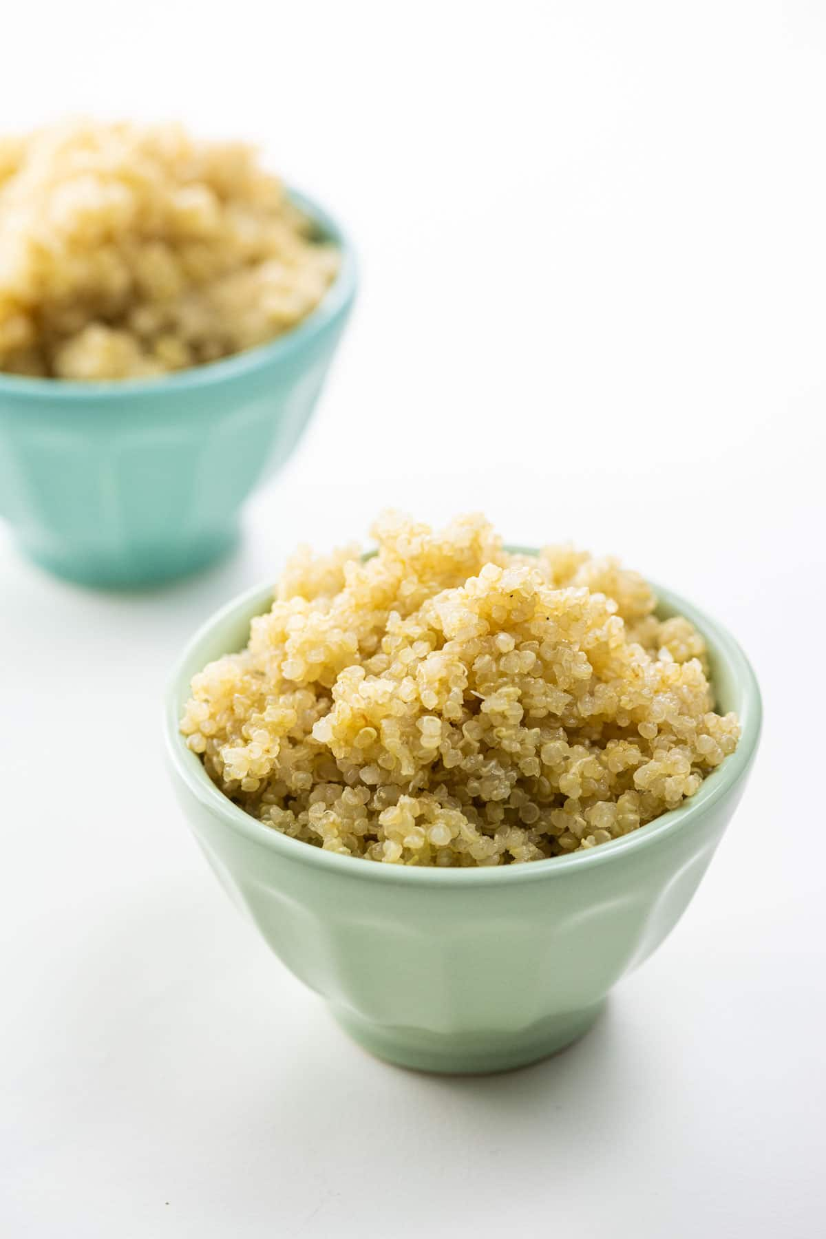 perfectly cooked quinoa in two small bowls