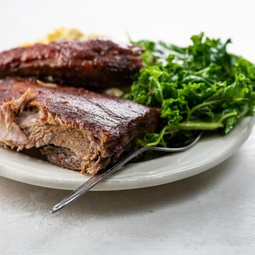 BBQ ribs, kale salad, and macaroni and cheese on a plate for Winter Favorites Category