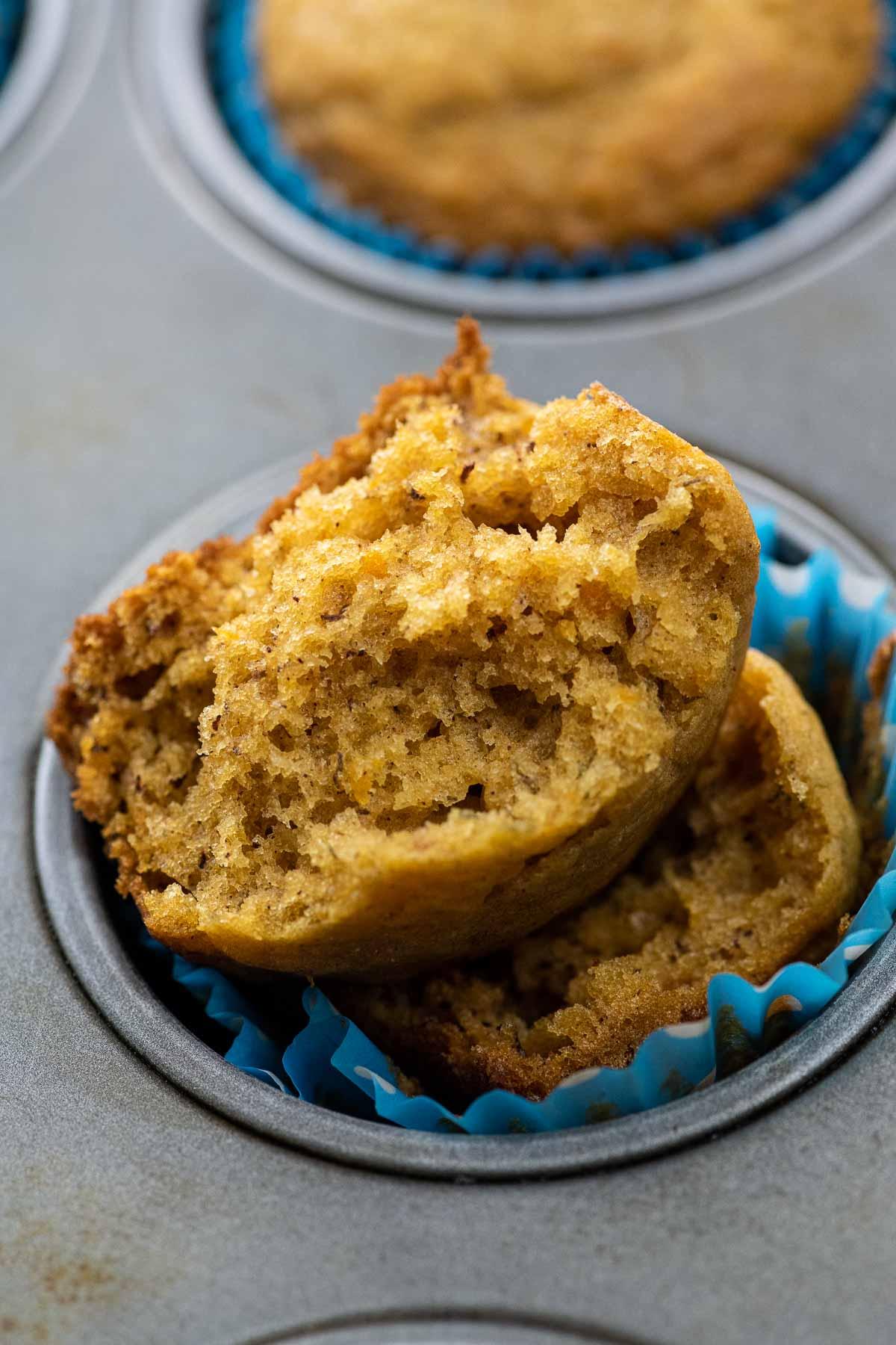 an open banana sweet potato muffin in a muffin tin