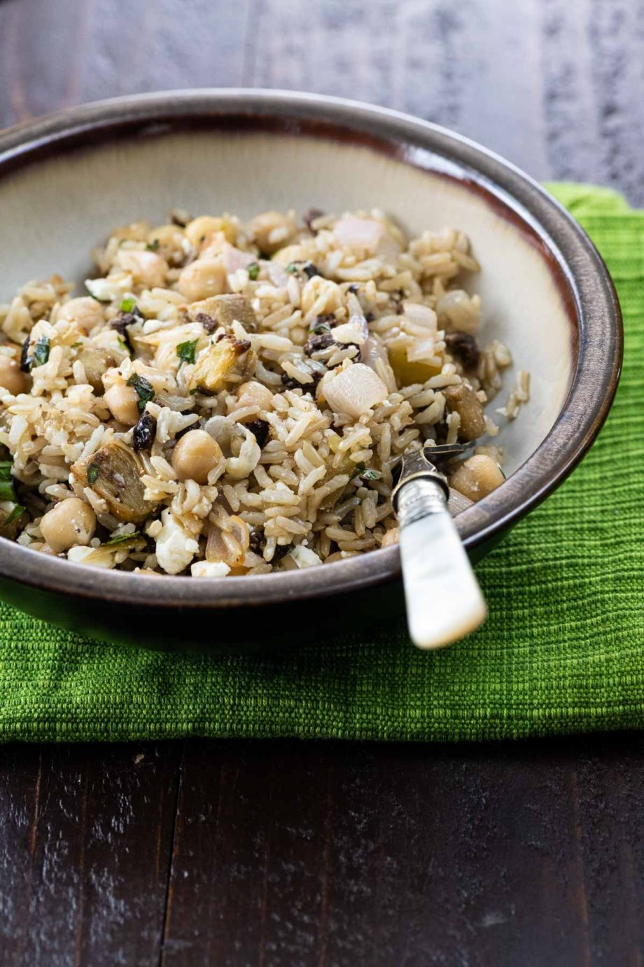 brown rice salad in a bowl with a fork