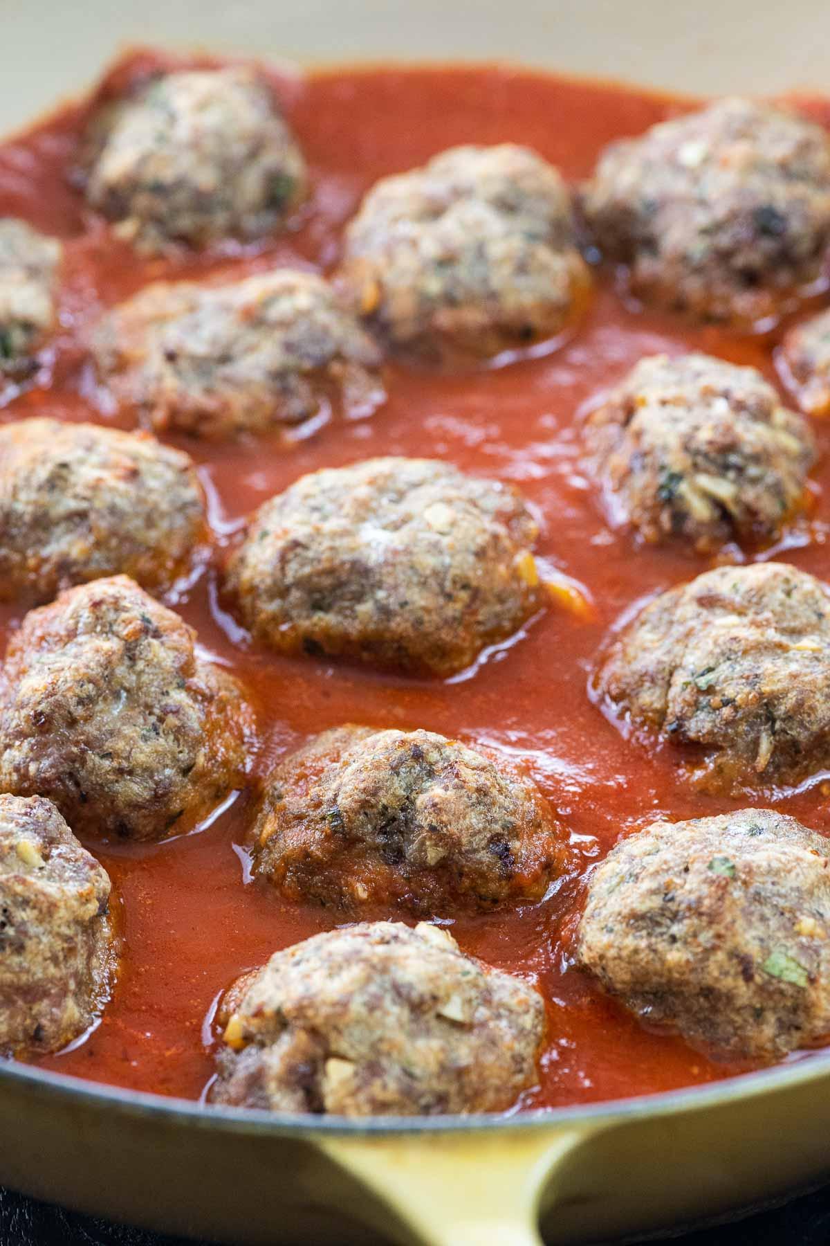 Grandma's Italian meatballs with tomato sauce in a pan