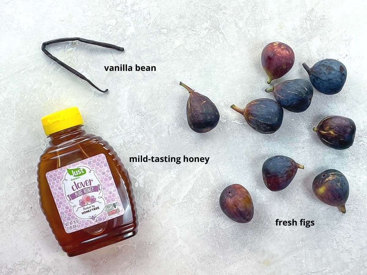 a jar of honey, a vanilla bean, and nine black mission figs