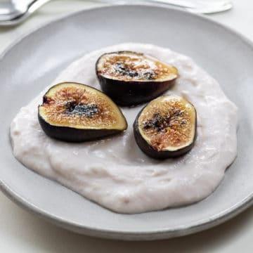 honey roasted figs over yogurt on small plates