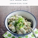 chickpea salad with Indian spices and yogurt in a bowl with a paper napkin and lemon wedge
