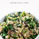mushrooms and rice with spinach in a white bowl