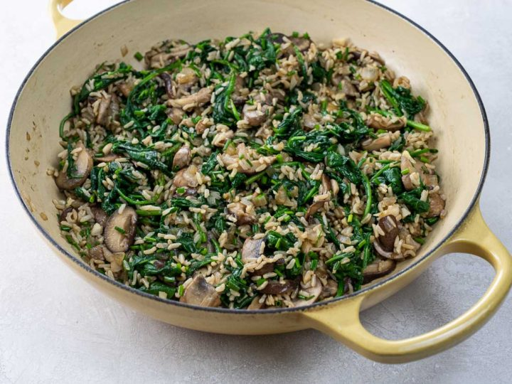 mushroom spinach rice in a pan
