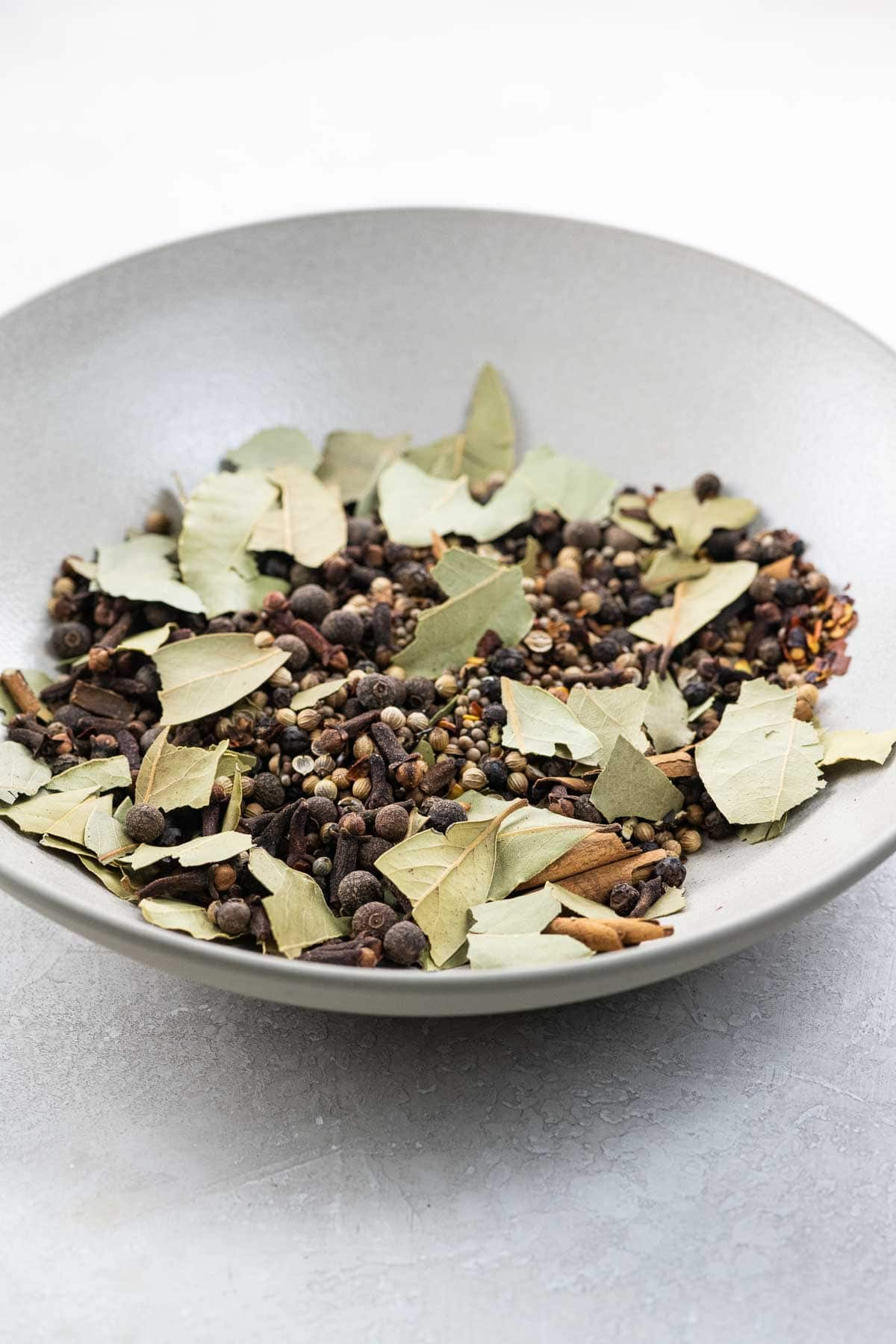 a bowl of pickling spice ingredients