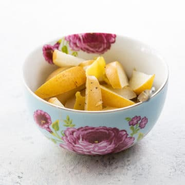 a decorative bowl of our poached asian pear dessert recipe