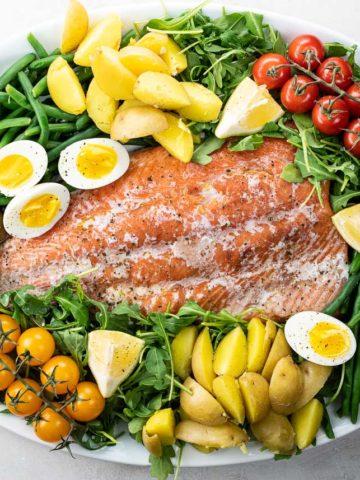 Salmon Nicoise salad on a platter