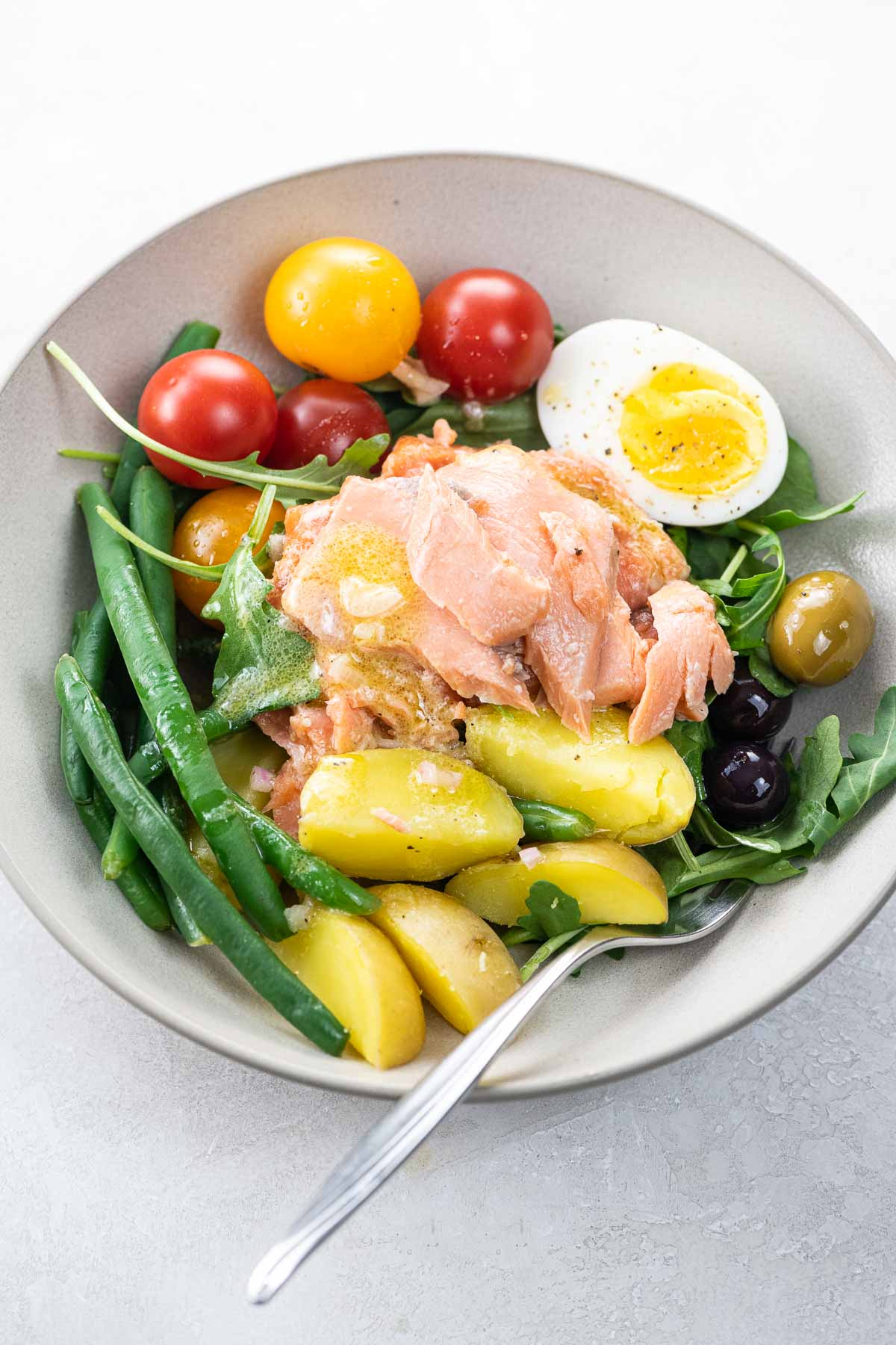 Salmon Nicoise salad in a bowl