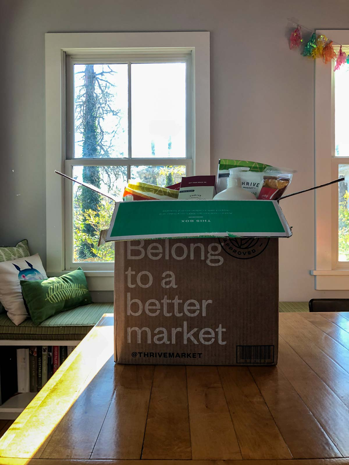a full box from Thrive Market on a table