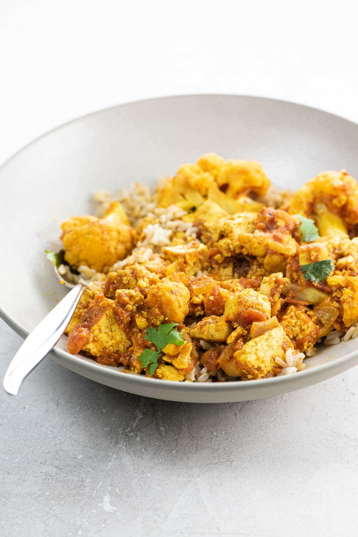 tofu curry with cauliflower in a bowl
