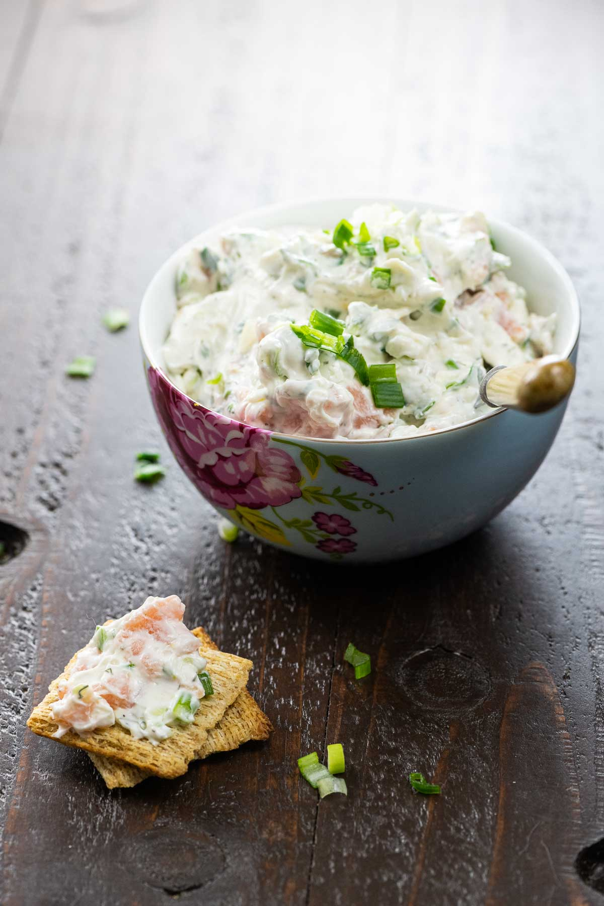 lox spread in a bowl and on crackers